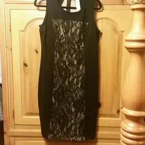 Black dress with Black lace and beige backing.